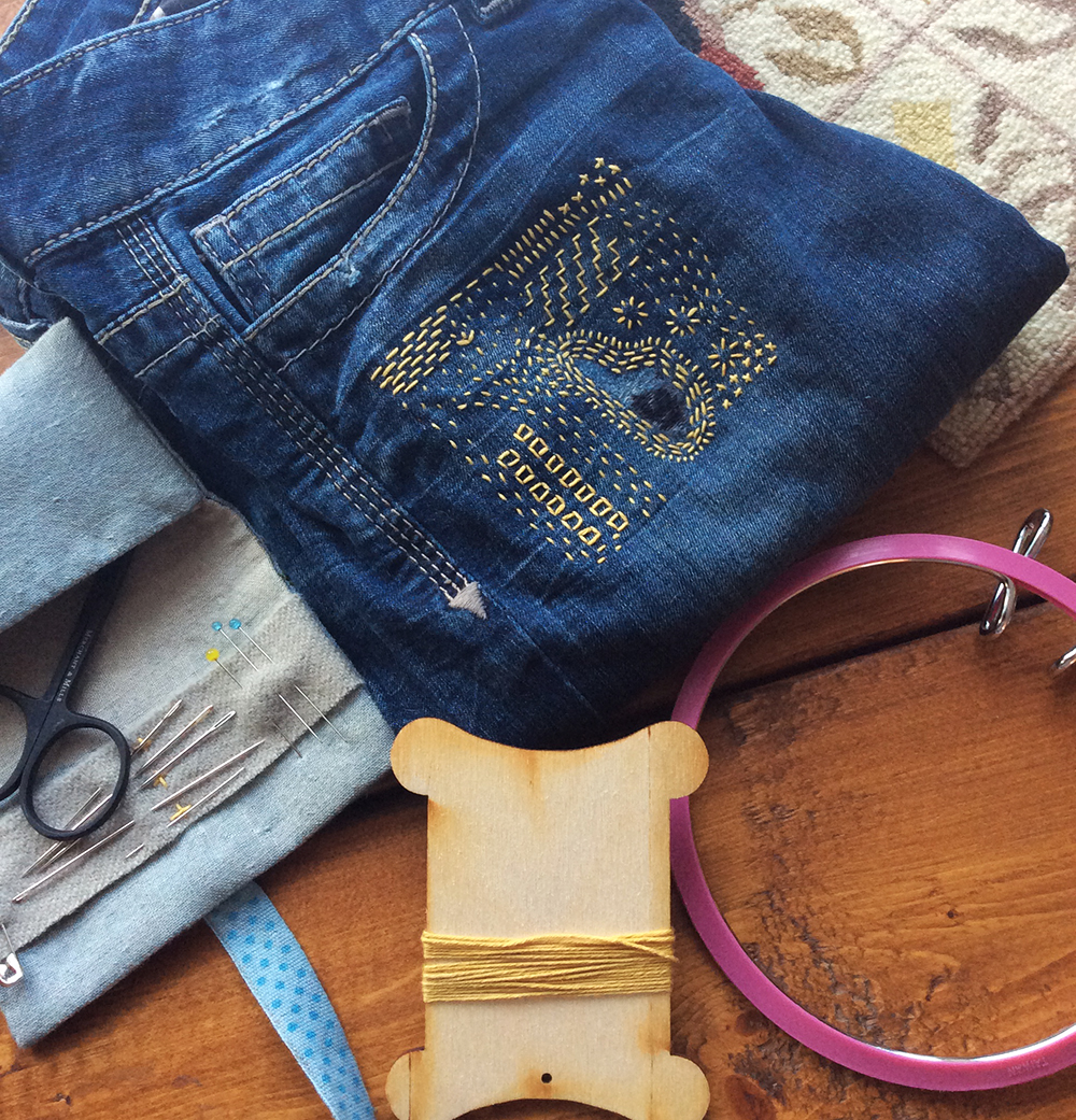Jeans with visible mending